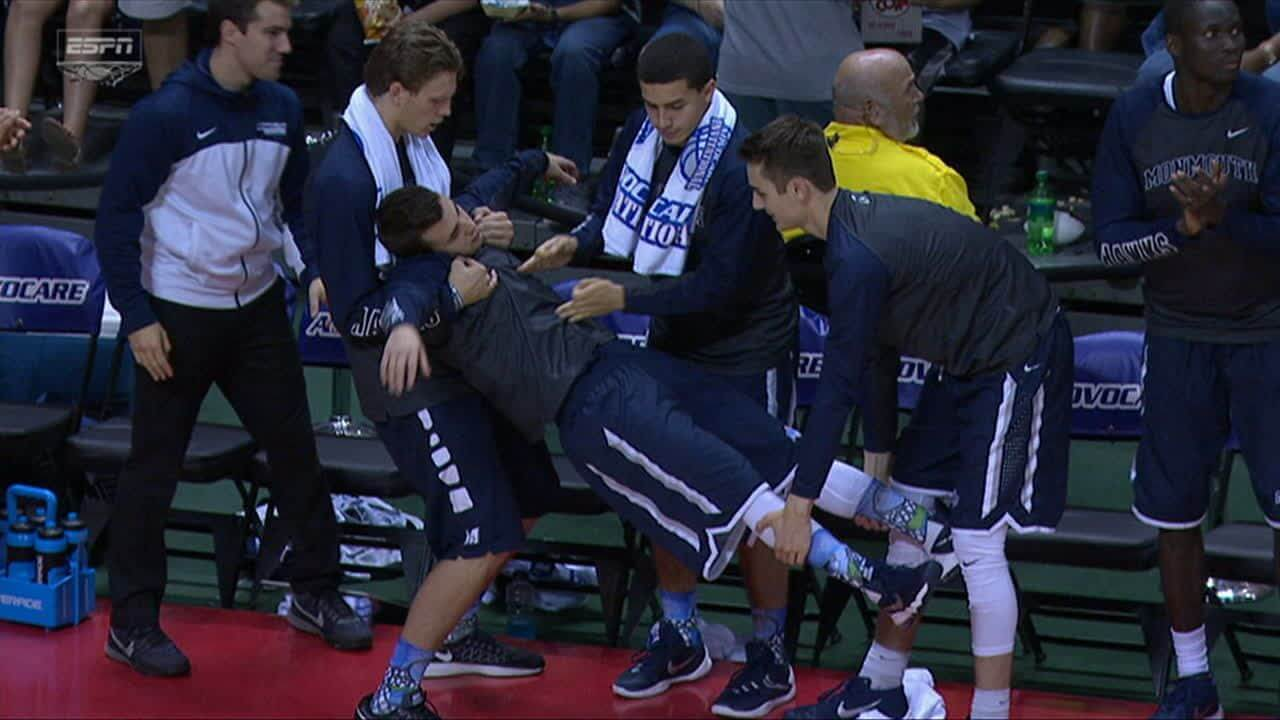 March Madness 2016: Monmouth bench celebrates Justin Robinson made Three Point Jumper.