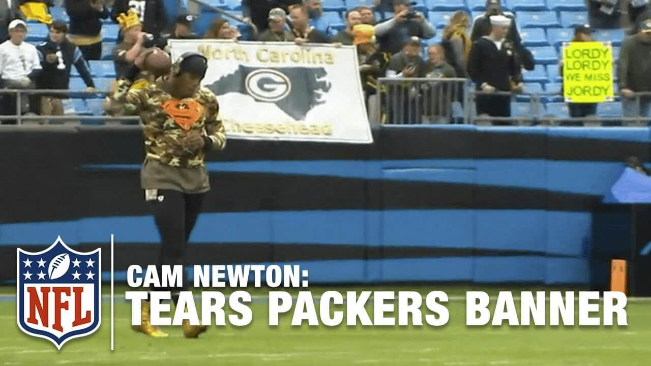 Cam Newton tears Packers banner