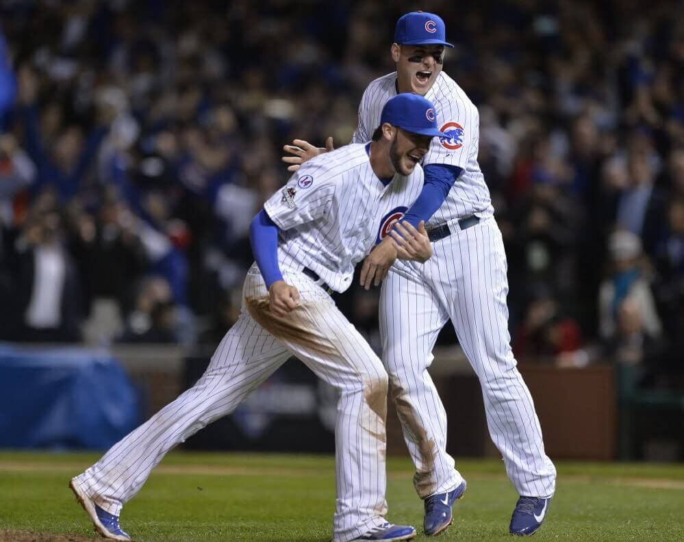 Chicago Cubs' Kris Bryant and Anthony Rizzo celebrate after winning Game 4 in baseball's National League Division Series, Tuesday, Oct. 13, 2015, in Chicago. The Cubs won 6-4.