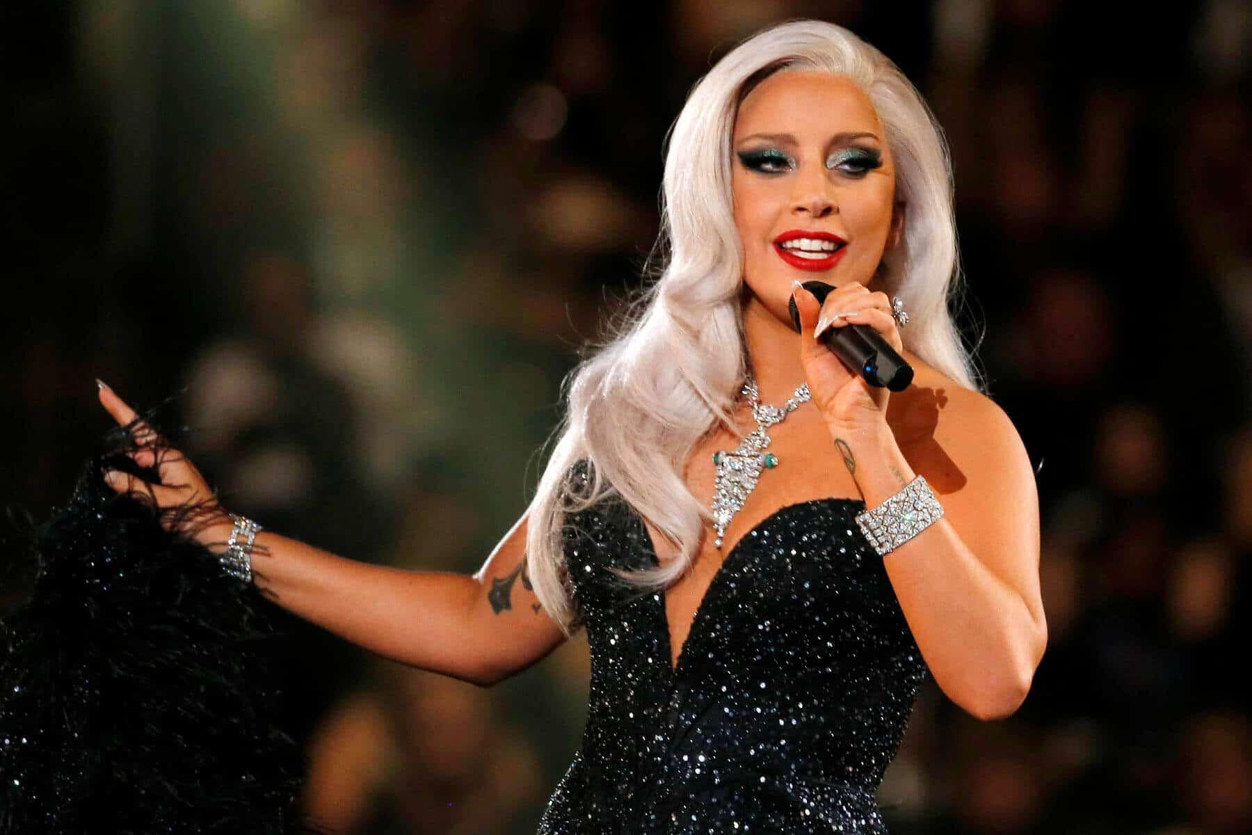 Lady Gaga singing in a black dress